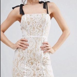 ASOS bodycon lace dress with black ties.